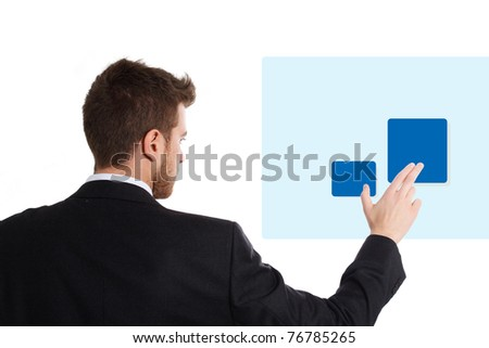 Young businessman using a virtual touchscreen. Isolated on white. - stock photo