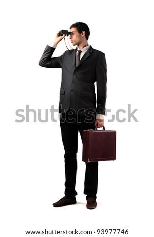 Young businessman using binoculars - stock photo