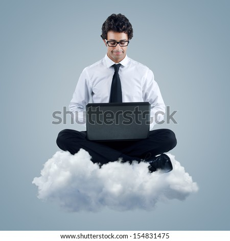 Young businessman using cloud computing technology - stock photo