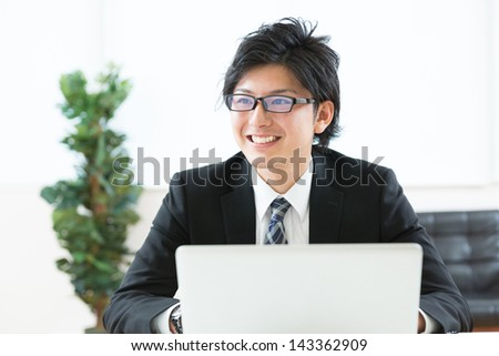 young businessman using computer - stock photo