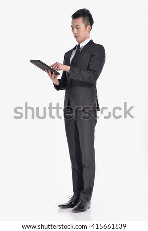 young businessman Using Digital Tablet Isolated in studio  young businessman Using Digital Tablet Isolated in studio   - stock photo