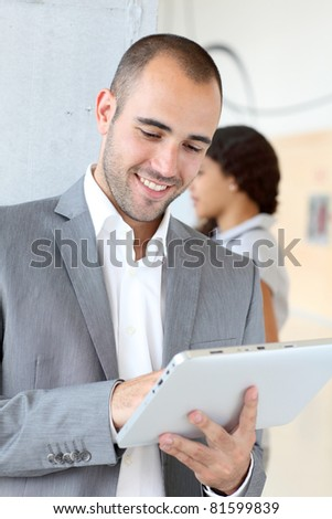 Young businessman using electronic tablet - stock photo