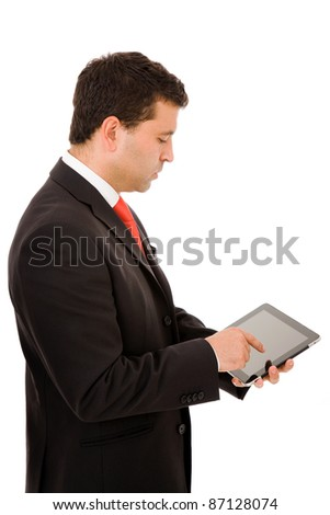 Young businessman using electronic tablet on white background