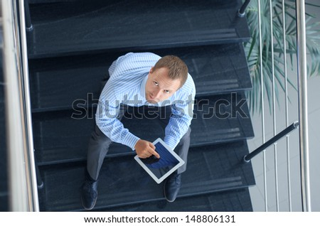 young businessman using his digital tablet at the office  - stock photo