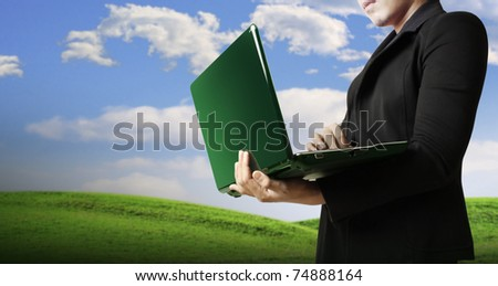 young businessman using laptop in business building - stock photo