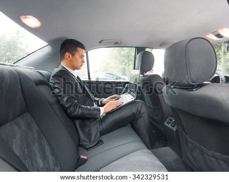 Young businessman using laptop on his way to the office