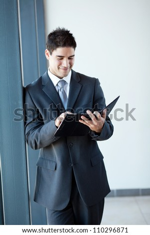 young businessman using tablet computer in office - stock photo