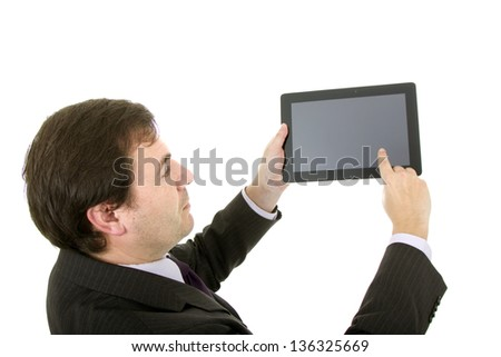 Young businessman using tablet while standing white background - stock photo