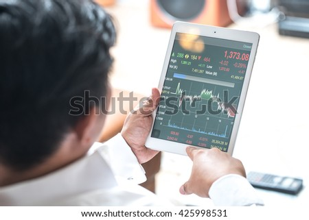 Young businessman using the touchpad. - stock photo