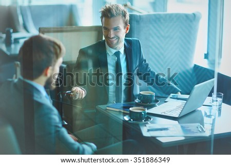 Young businessman voicing his ideas or plans - stock photo
