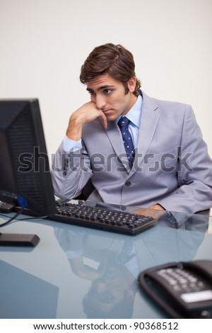 Young businessman waiting for his computer to work