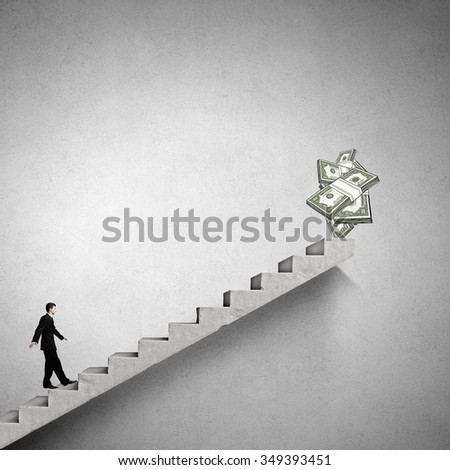 Young businessman walking up on staircase representing success concept - stock photo