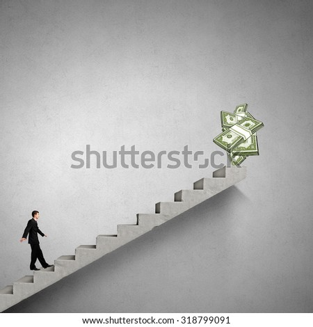 Young businessman walking up staircase representing success concept - stock photo