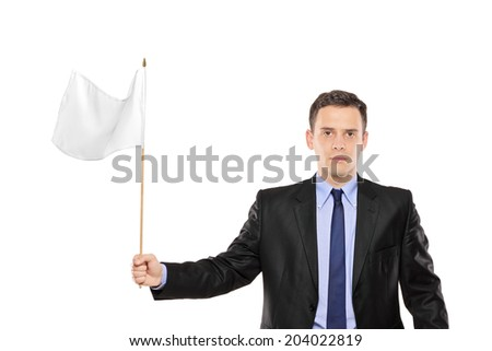 Young businessman waving a white flag isolated on white background - stock photo