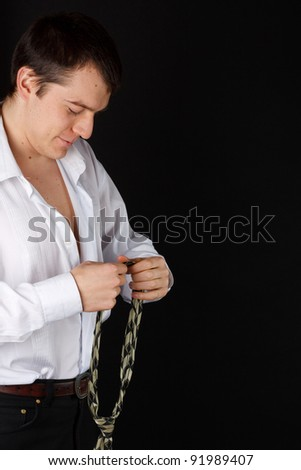 Young businessman wearing a tie - stock photo