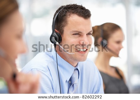 Young businessman wearing headset