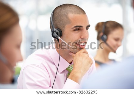 Young businessman wearing headset - stock photo