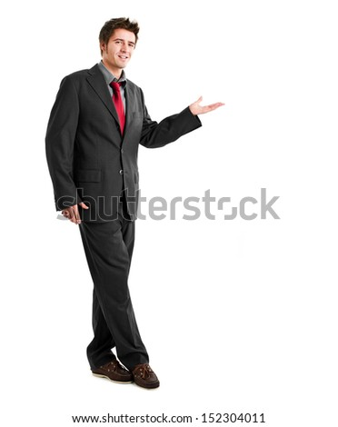 Young businessman welcoming you - stock photo