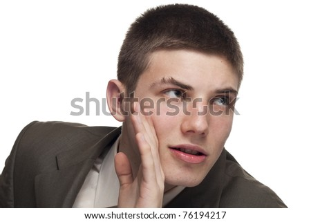 Young businessman whispering something to someone - stock photo