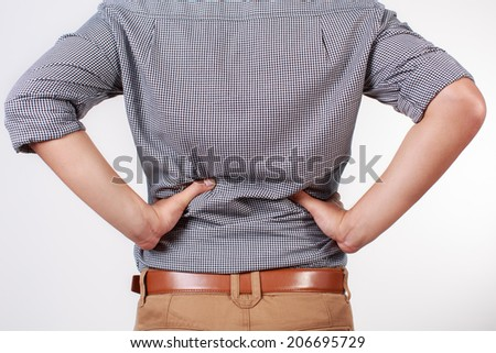 Young businessman with a backache isolated on white background - stock photo