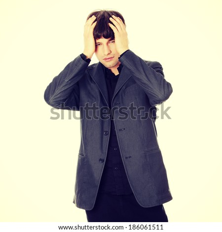 Young businessman with a big headache or problem - stock photo