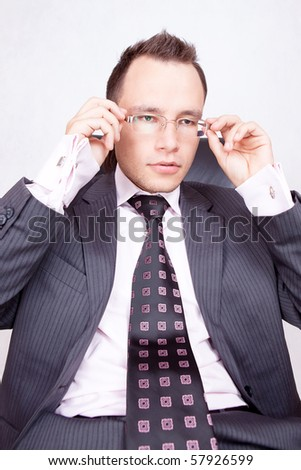 Young businessman with a pair of modern glasses.
