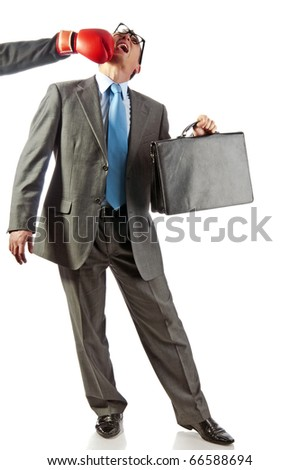 young businessman with a portfolio in a hand is knocked out. Isolated on white - stock photo