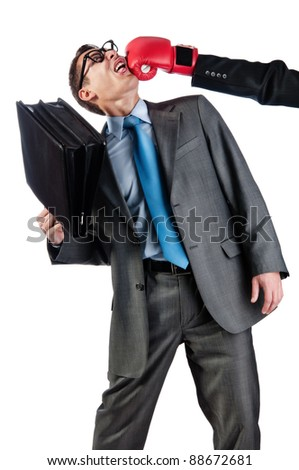 young businessman with a portfolio is knocked out. Isolated on white