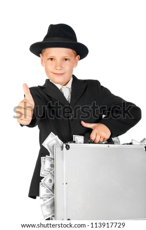 young businessman with a suitcase of money showing thumbs up - stock photo