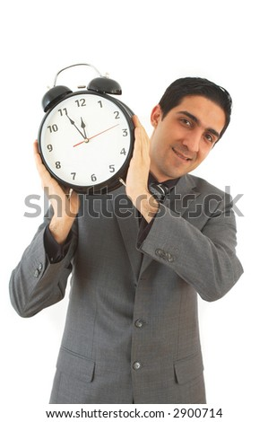 young businessman with alarm clock on white