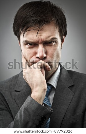 Young businessman with an expression of intense concentration - stock photo