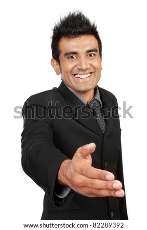 young businessman with an open hand ready to make a deal - stock photo