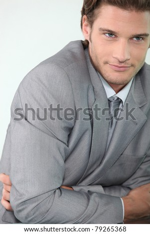 Young businessman with arms folded - stock photo