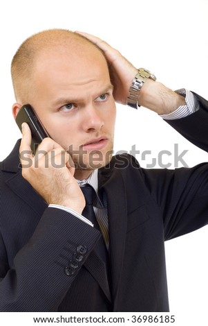 young businessman with bad news on his cell phone - stock photo