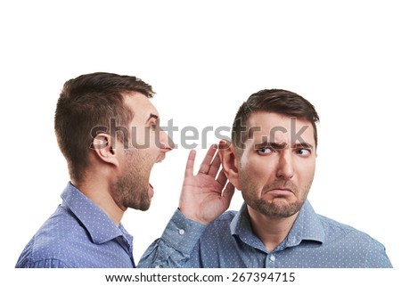 young businessman with big ear listening angry screaming man. isolated on white background - stock photo