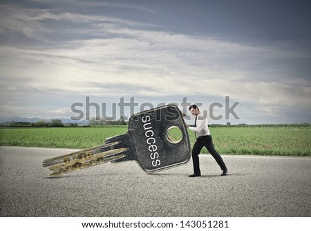 young businessman with big key - stock photo