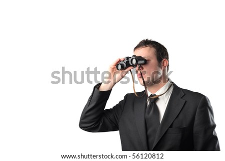 Young businessman with binoculars - stock photo
