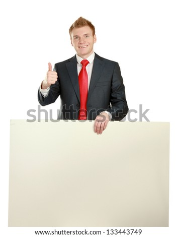 Young businessman with blank board showing thumb up isolated on white background. - stock photo
