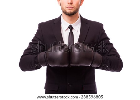 young businessman with boxing gloves ready for battle - stock photo