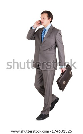 young businessman with briefcase isolated on white background - stock photo
