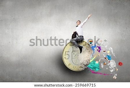 Young businessman with briefcase riding euro symbol - stock photo