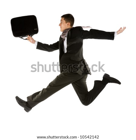 young businessman with briefcase running for success - stock photo