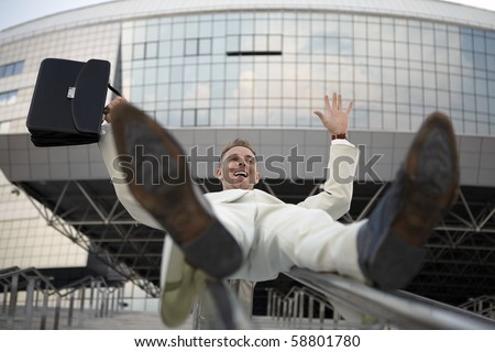 young businessman with briefcase running on stair - stock photo