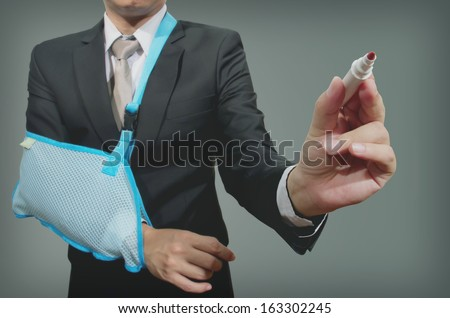 young businessman with broken hand wearing an arm brace, series - stock photo