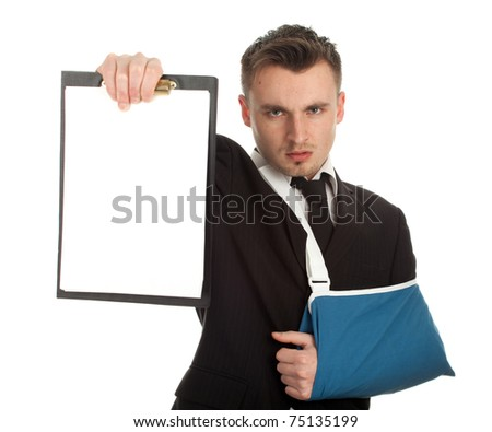 young businessman with broken hand wearing an arm braceand blank card, series - stock photo
