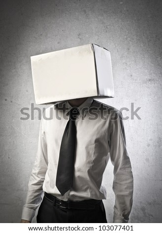 Young businessman with carton covering his head - stock photo