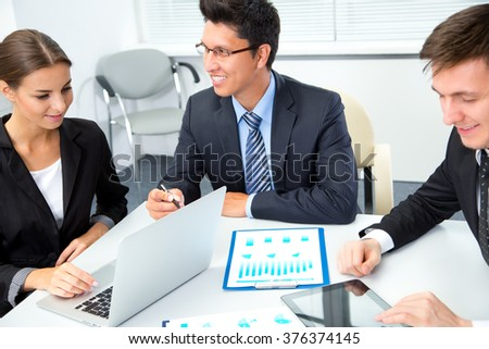 Young businessman with colleagues in modern office - stock photo