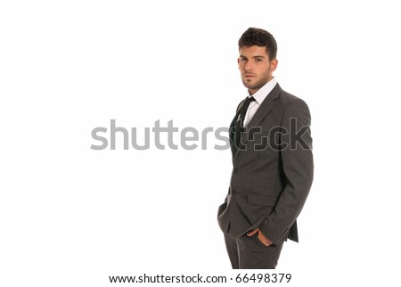 Young businessman with copy-space looking serious hands in pockets isolated on white background
