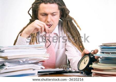 Young businessman with dreadlocks trying to meet deadlines