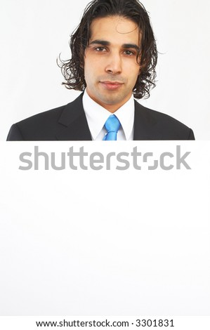 young businessman with empty board for your messages - stock photo